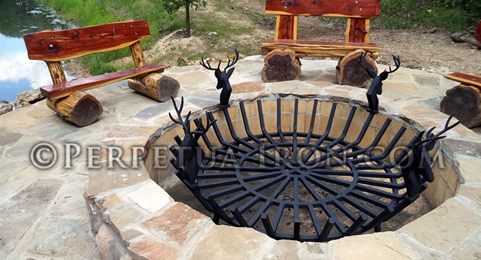 Large scale custom fireplace grate used in outdoor firepit.