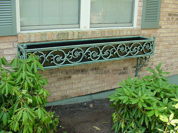 A wrought iron window box.
