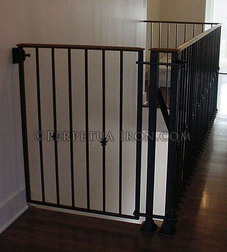 Baby Gate Integrated Into Design Of Railing At Top Of Stairs.