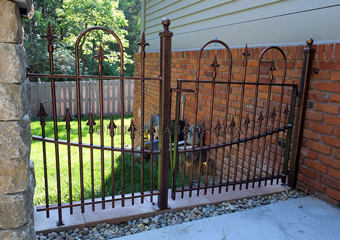 Loop and spear design in a custom iron gate.