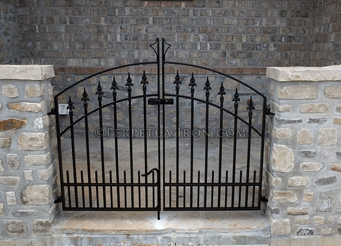 Custom iron gate for the entrance to a home.