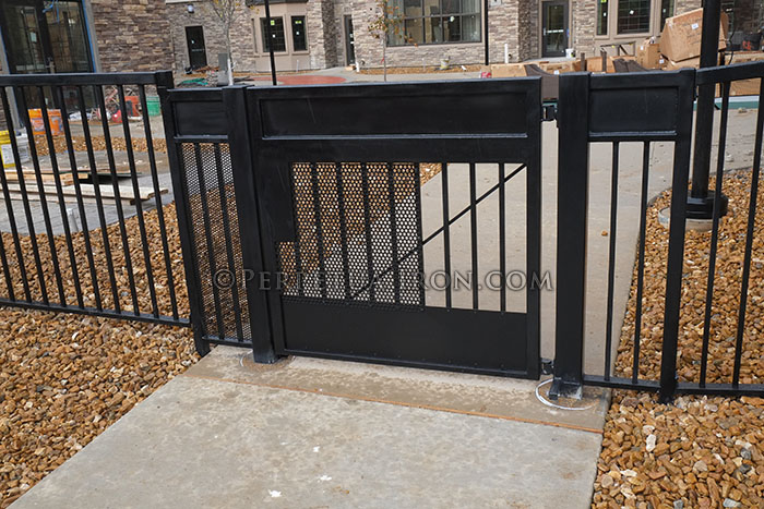 Iron gate with solid panels for commercial site secuity.