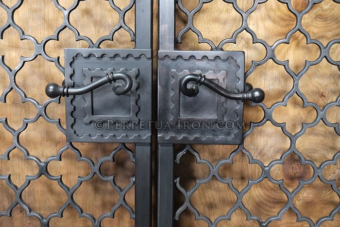 Close up view of custom handles on iron gates.