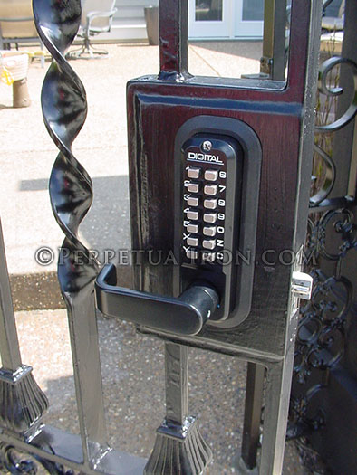 Detail shot of a mechanical digital lock for a garden gate with two columns of buttons.