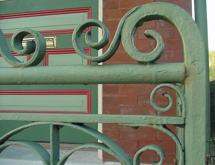 detail of 2.0 a rivetted iron porch railing.