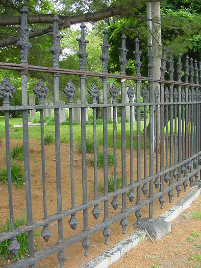 Cemetery rail with cast iron components, heavily built.
