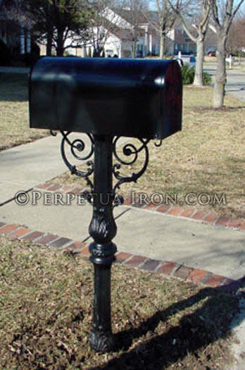 A stout ornamental mailbox post showing a tapered symmetrical design.