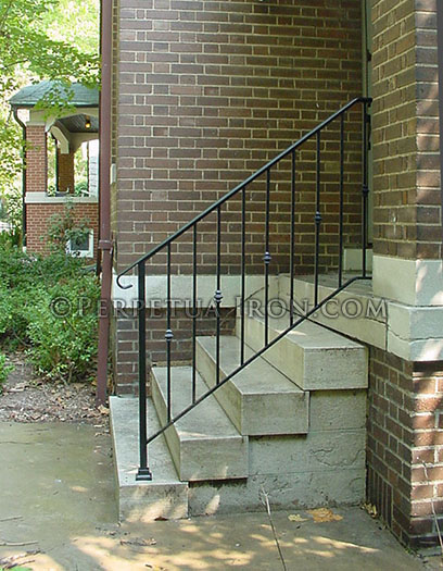 Wrought iron railing for steps, classic design with alternating nodes.