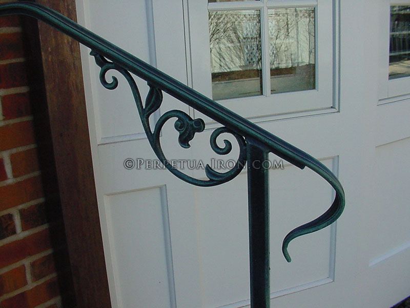 Detail of wrought iron lamb's tongue, antique green finish.