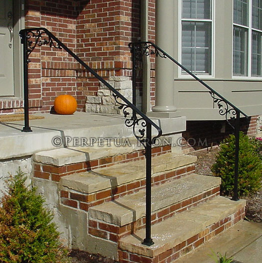 Wrought iron  railing for front steps, cast iron elements.