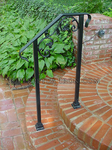 Wrought iron railing for garden steps, cast iron elements.