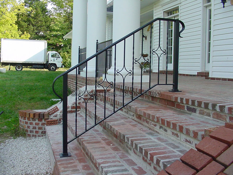 Stair railing with D shaped end that wraps back to the main posts.