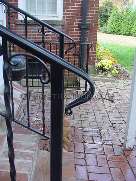 Exterior wrought iron railing, 2 channel design with ball cap finials.