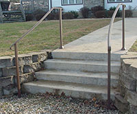 exterior wrought iron handrail, curved on site, bronze color