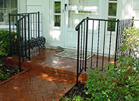 wrought iron porch railing, design is alternating twisted pickets