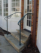 curved wrought iron handrail, lamb's tongue ends, cast iron scrolls
