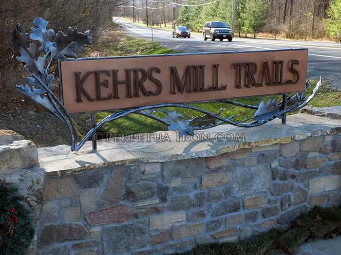 Custom iron subdivision sign with hand forged elements.