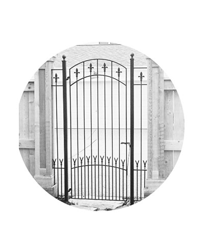 White box with a silhouette of a iron gate, with the word Gates written above it.